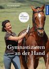 Gymnastizieren an der Hand